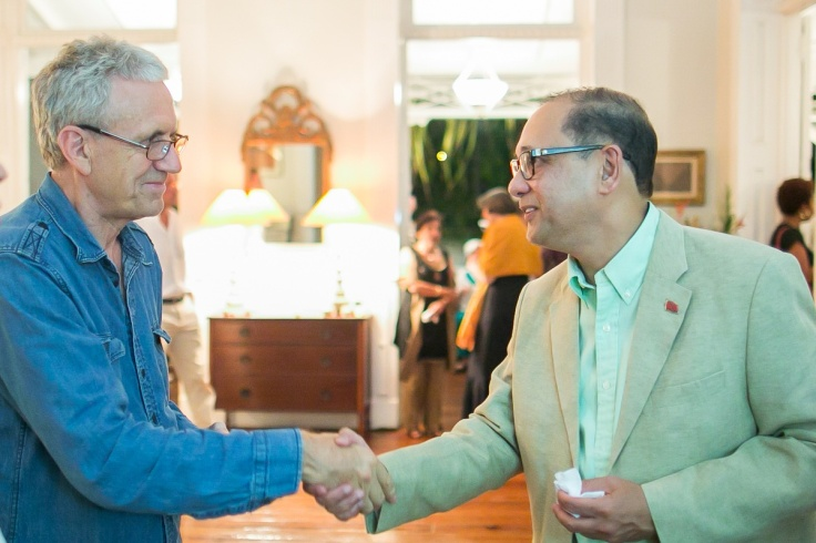 ttff's founder and director, Dr Bruce Paddington (left) greets T&T's Minister of Finance - Larry Howai at a ttff/14 reception